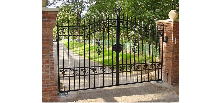 Swinging metal property gates